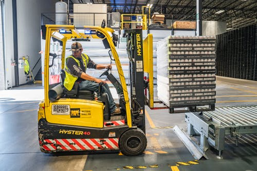 Pallet Stacker Trucks Benefits To Businesses